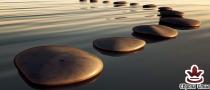 фототапет панел с пътека от спа камъни върху вода